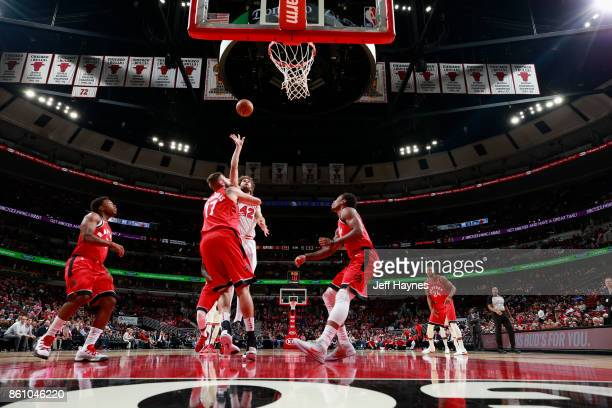 Robin Lopez of the Chicago Bulls goes to the basket against the Toronto Raptors on October 13 2017 at the United Center in Chicago Illinois NOTE TO...