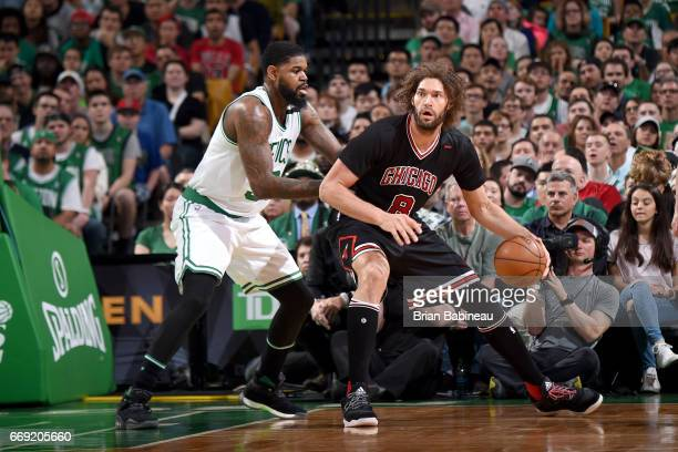 Robin Lopez of the Chicago Bulls handles the ball against the Boston Celtics during the Eastern Conference Quarterfinals of the 2017 NBA Playoffs on...