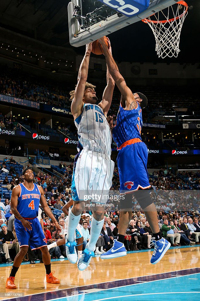 Robin Lopez #15 of the New Orleans Hornets attempts a shot against Rasheed Wallace #36 of the New York Knicks on November 20, 2012 at the New Orleans Arena in New Orleans, Louisiana.
