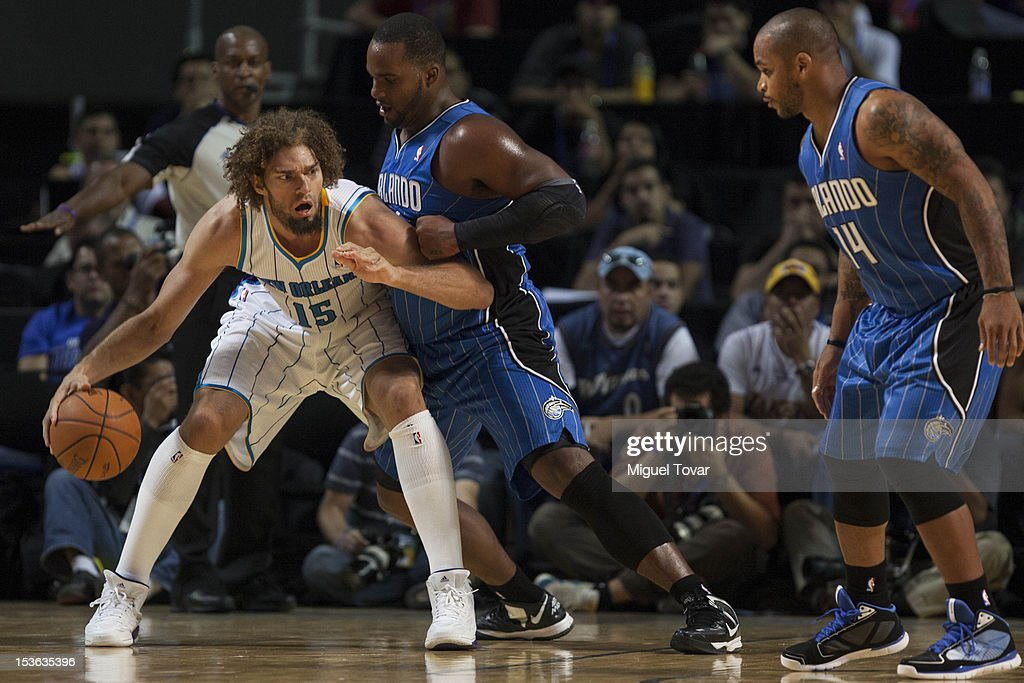 <a gi-track='captionPersonalityLinkClicked' href=/galleries/search?phrase=Robin+Lopez&family=editorial&specificpeople=2351509 ng-click='$event.stopPropagation()'>Robin Lopez</a> #15 of the New Orleans Hornets drives the ball as <a gi-track='captionPersonalityLinkClicked' href=/galleries/search?phrase=Glen+Davis+-+Basketball+Player&family=editorial&specificpeople=709385 ng-click='$event.stopPropagation()'>Glen Davis</a> #11 of the Orlando Magic defends, during the game between the Orlando Magic and the New Orleans Hornets on October 7, 2012 at Mexico City Arena in Mexico City.