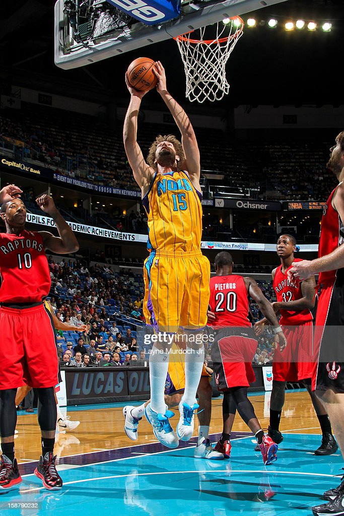 Robin Lopez #15 of the New Orleans Hornets drives to the basket against the Toronto Raptors on December 28, 2012 at the New Orleans Arena in New Orleans, Louisiana.