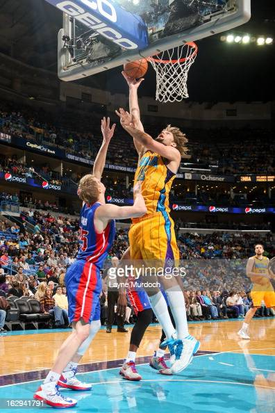 Robin Lopez of the New Orleans Hornets drives to the basket against Kyle Singler of the Detroit Pistons on March 1 2013 at the New Orleans Arena in...