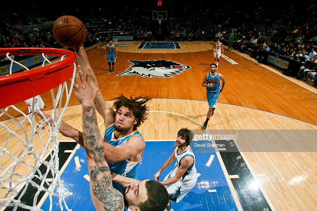 <a gi-track='captionPersonalityLinkClicked' href=/galleries/search?phrase=Robin+Lopez&family=editorial&specificpeople=2351509 ng-click='$event.stopPropagation()'>Robin Lopez</a> #15 of the New Orleans Hornets drives to the basket against <a gi-track='captionPersonalityLinkClicked' href=/galleries/search?phrase=Nikola+Pekovic&family=editorial&specificpeople=829137 ng-click='$event.stopPropagation()'>Nikola Pekovic</a> #14 of the Minnesota Timberwolves on March 17, 2013 at Target Center in Minneapolis, Minnesota.