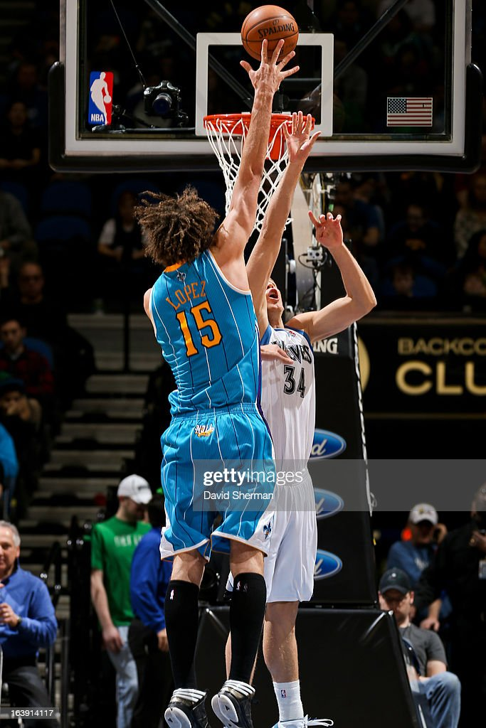 <a gi-track='captionPersonalityLinkClicked' href=/galleries/search?phrase=Robin+Lopez&family=editorial&specificpeople=2351509 ng-click='$event.stopPropagation()'>Robin Lopez</a> #15 of the New Orleans Hornets drives to the basket against <a gi-track='captionPersonalityLinkClicked' href=/galleries/search?phrase=Greg+Stiemsma&family=editorial&specificpeople=2098297 ng-click='$event.stopPropagation()'>Greg Stiemsma</a> #34 of the Minnesota Timberwolves on March 17, 2013 at Target Center in Minneapolis, Minnesota.