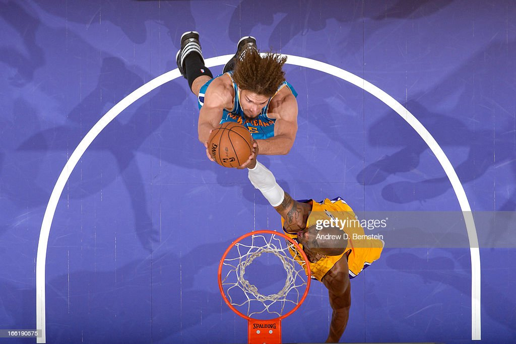 Robin Lopez #15 of the New Orleans Hornets drives to the basket against Kobe Bryant #24 of the Los Angeles Lakers at Staples Center on April 9, 2013 in Los Angeles, California.