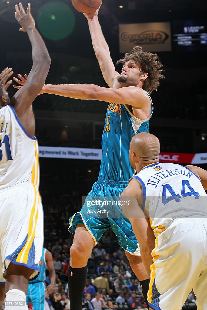 Robin Lopez #15 of the New Orleans Hornets drives to the basket against the Golden State Warriors on April 3, 2013 at Oracle Arena in Oakland, California.