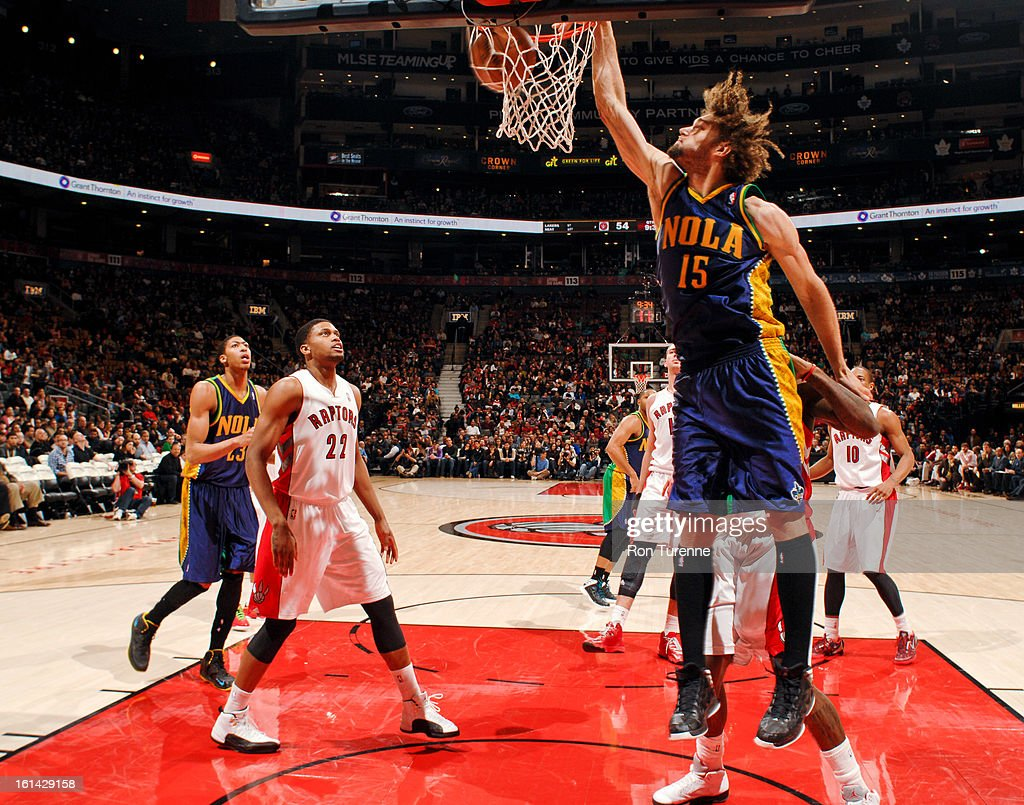 <a gi-track='captionPersonalityLinkClicked' href=/galleries/search?phrase=Robin+Lopez&family=editorial&specificpeople=2351509 ng-click='$event.stopPropagation()'>Robin Lopez</a> #15 of the New Orleans Hornets dunks against the Toronto Raptors on February 10, 2013 at the Air Canada Centre in Toronto, Ontario, Canada.