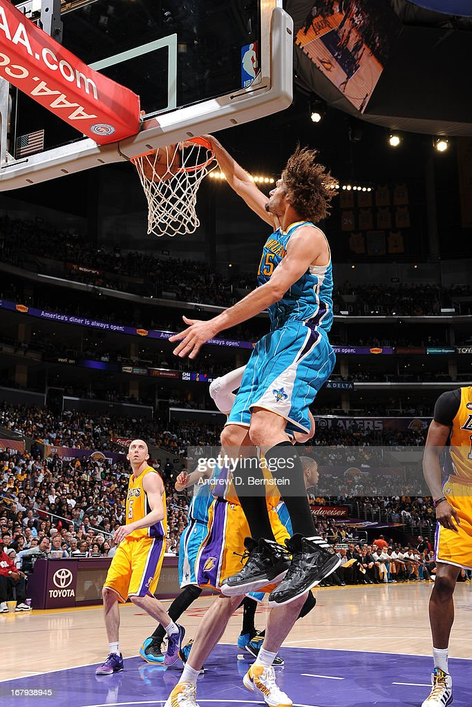 Robin Lopez #15 of the New Orleans Hornets dunks the ball against the Los Angeles Lakers at Staples Center on April 9, 2013 in Los Angeles, California.