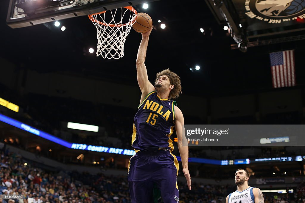 <a gi-track='captionPersonalityLinkClicked' href=/galleries/search?phrase=Robin+Lopez&family=editorial&specificpeople=2351509 ng-click='$event.stopPropagation()'>Robin Lopez</a> #15 of the New Orleans Hornets dunks the ball against the Minnesota Timberwolves on February 2, 2013 at Target Center in Minneapolis, Minnesota.