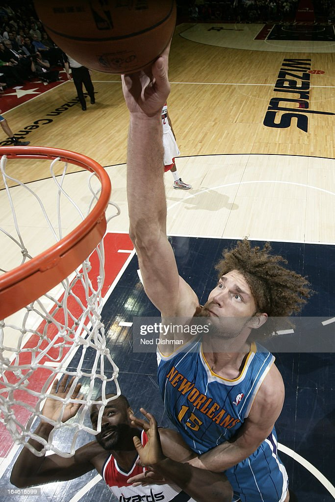<a gi-track='captionPersonalityLinkClicked' href=/galleries/search?phrase=Robin+Lopez&family=editorial&specificpeople=2351509 ng-click='$event.stopPropagation()'>Robin Lopez</a> #15 of the New Orleans Hornets dunks the ball against the Washington Wizards at the Verizon Center on March 15, 2013 in Washington, DC.