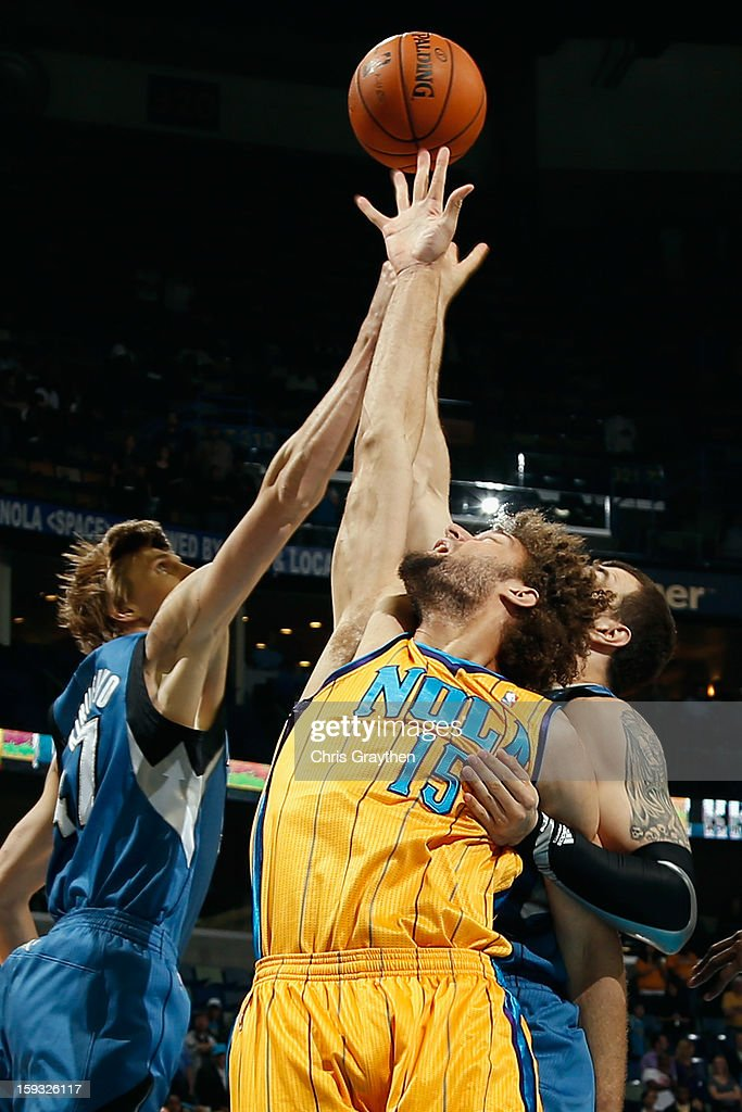 Robin Lopez #15 of the New Orleans Hornets fights for a rebound with Andrei Kirilenko #47 of the Minnesota Timberwolves at New Orleans Arena on January 11, 2013 in New Orleans, Louisiana.