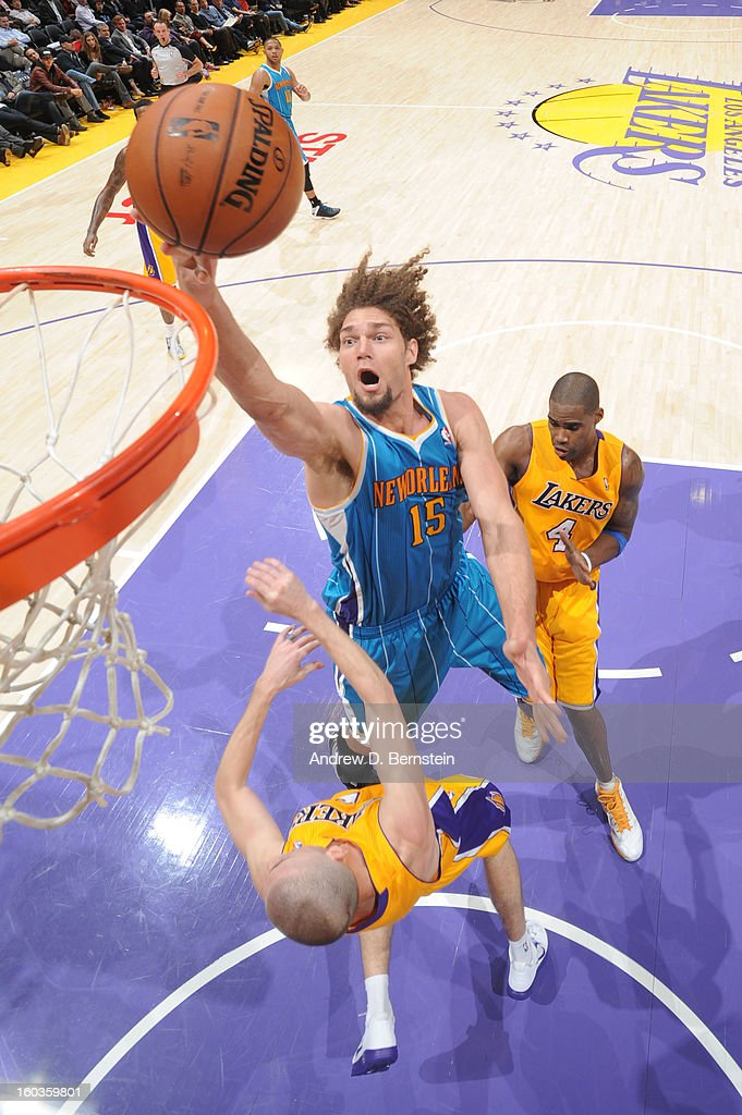 Robin Lopez #15 of the New Orleans Hornets goes up for a shot against Steve Blake #5 of the Los Angeles Lakers at Staples Center on January 29, 2013 in Los Angeles, California.