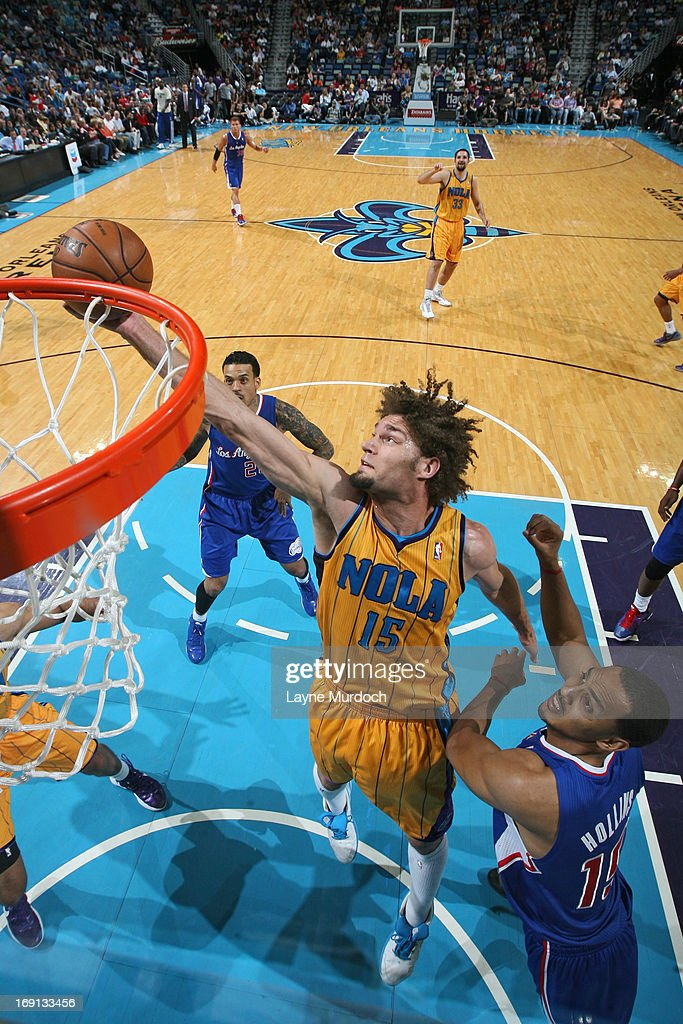 <a gi-track='captionPersonalityLinkClicked' href=/galleries/search?phrase=Robin+Lopez&family=editorial&specificpeople=2351509 ng-click='$event.stopPropagation()'>Robin Lopez</a> #15 of the New Orleans Hornets grabs a rebound against <a gi-track='captionPersonalityLinkClicked' href=/galleries/search?phrase=Ryan+Hollins&family=editorial&specificpeople=182556 ng-click='$event.stopPropagation()'>Ryan Hollins</a> #15 of the Los Angeles Clippers on April 12, 2013 at the New Orleans Arena in New Orleans, Louisiana.