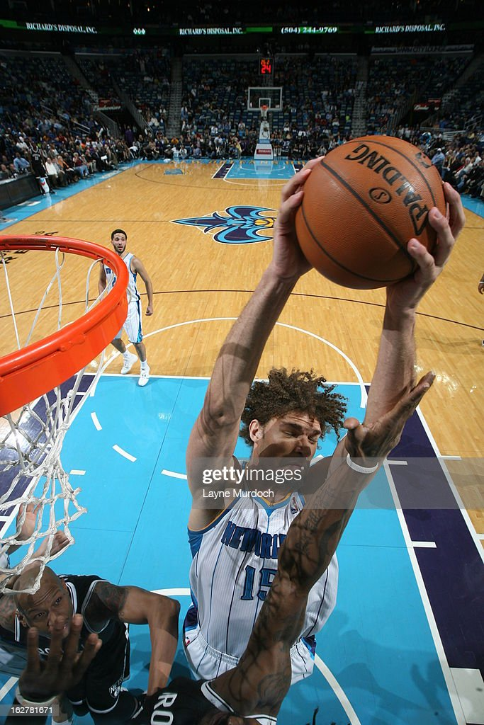<a gi-track='captionPersonalityLinkClicked' href=/galleries/search?phrase=Robin+Lopez&family=editorial&specificpeople=2351509 ng-click='$event.stopPropagation()'>Robin Lopez</a> #15 of the New Orleans Hornets grabs a rebound against the Brooklyn Nets on February 26, 2013 at the New Orleans Arena in New Orleans, Louisiana.