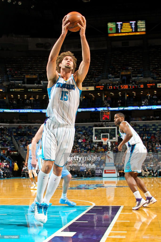 <a gi-track='captionPersonalityLinkClicked' href=/galleries/search?phrase=Robin+Lopez&family=editorial&specificpeople=2351509 ng-click='$event.stopPropagation()'>Robin Lopez</a> #15 of the New Orleans Hornets grabs a rebound against the Denver Nuggets on March 25, 2013 at the New Orleans Arena in New Orleans, Louisiana.