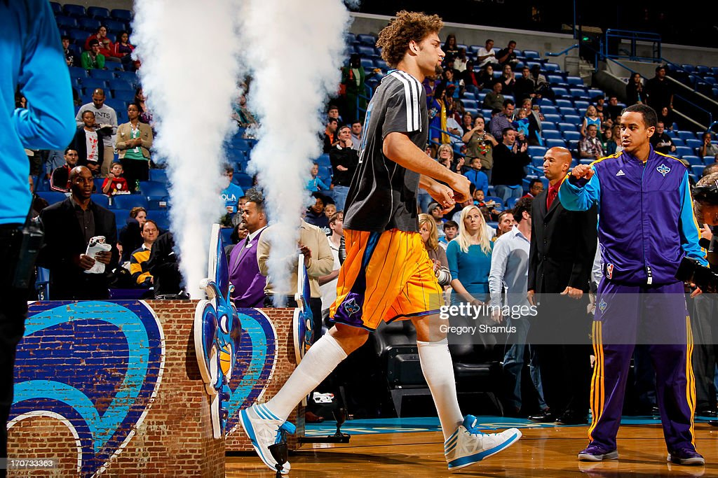 <a gi-track='captionPersonalityLinkClicked' href=/galleries/search?phrase=Robin+Lopez&family=editorial&specificpeople=2351509 ng-click='$event.stopPropagation()'>Robin Lopez</a> #15 of the New Orleans Hornets greets teammates before playing against the Minnesota Timberwolves on December 14, 2012 at the New Orleans Arena in New Orleans, Louisiana.