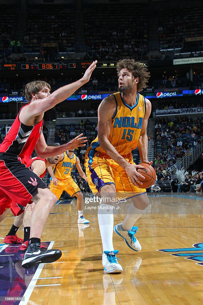 <a gi-track='captionPersonalityLinkClicked' href=/galleries/search?phrase=Robin+Lopez&family=editorial&specificpeople=2351509 ng-click='$event.stopPropagation()'>Robin Lopez</a> #15 of the New Orleans Hornets looks go shoot against the Toronto Raptors on December 28, 2012 at the New Orleans Arena in New Orleans, Louisiana.
