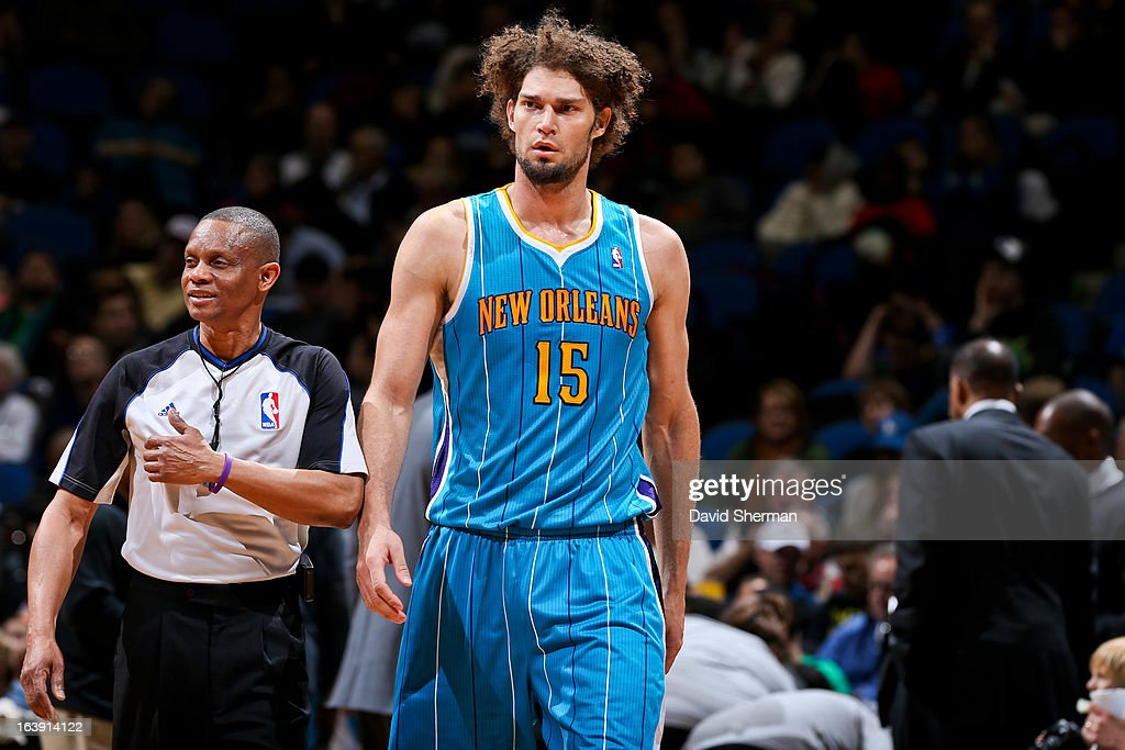 <a gi-track='captionPersonalityLinkClicked' href=/galleries/search?phrase=Robin+Lopez&family=editorial&specificpeople=2351509 ng-click='$event.stopPropagation()'>Robin Lopez</a> #15 of the New Orleans Hornets looks on during a game against the Minnesota Timberwolves on March 17, 2013 at Target Center in Minneapolis, Minnesota.