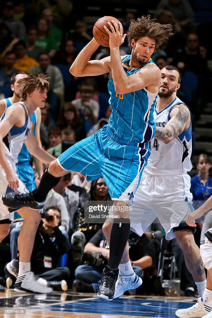 <a gi-track='captionPersonalityLinkClicked' href=/galleries/search?phrase=Robin+Lopez&family=editorial&specificpeople=2351509 ng-click='$event.stopPropagation()'>Robin Lopez</a> #15 of the New Orleans Hornets looks to pass the ball against the Minnesota Timberwolves on March 17, 2013 at Target Center in Minneapolis, Minnesota.