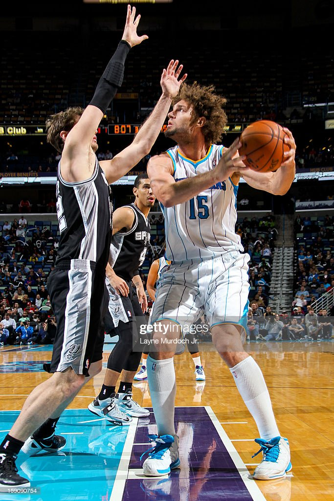 Robin Lopez #15 of the New Orleans Hornets looks to shoot against Tiago Splitter #22 of the San Antonio Spurs on January 7, 2013 at the New Orleans Arena in New Orleans, Louisiana.