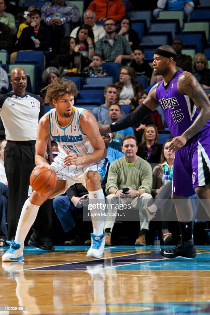 Robin Lopez #15 of the New Orleans Hornets posts up against DeMarcus Cousins #15 of the Sacramento Kings on February 24, 2013 at the New Orleans Arena in New Orleans, Louisiana.