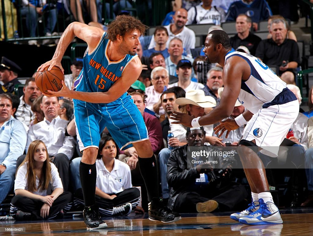 Robin Lopez #15 of the New Orleans Hornets posts up against Elton Brand #42 of the Dallas Mavericks on April 17, 2013 at the American Airlines Center in Dallas, Texas.