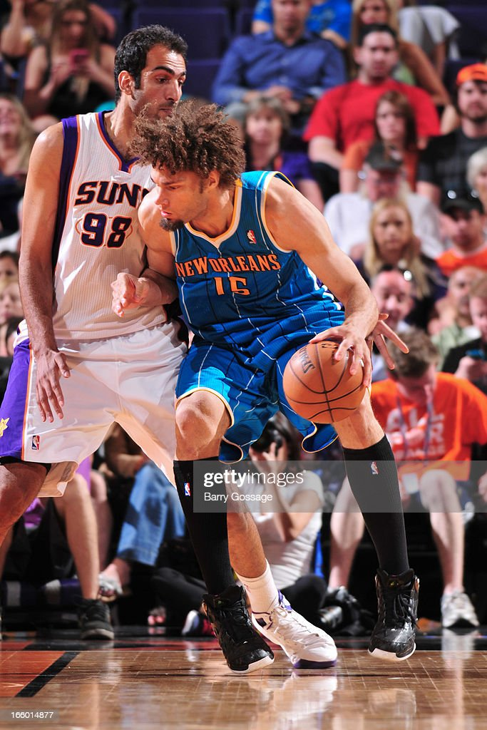 <a gi-track='captionPersonalityLinkClicked' href=/galleries/search?phrase=Robin+Lopez&family=editorial&specificpeople=2351509 ng-click='$event.stopPropagation()'>Robin Lopez</a> #15 of the New Orleans Hornets posts-up against <a gi-track='captionPersonalityLinkClicked' href=/galleries/search?phrase=Hamed+Haddadi&family=editorial&specificpeople=5544688 ng-click='$event.stopPropagation()'>Hamed Haddadi</a> #98 of the Phoenix Suns on April 7, 2013 at U.S. Airways Center in Phoenix, Arizona.
