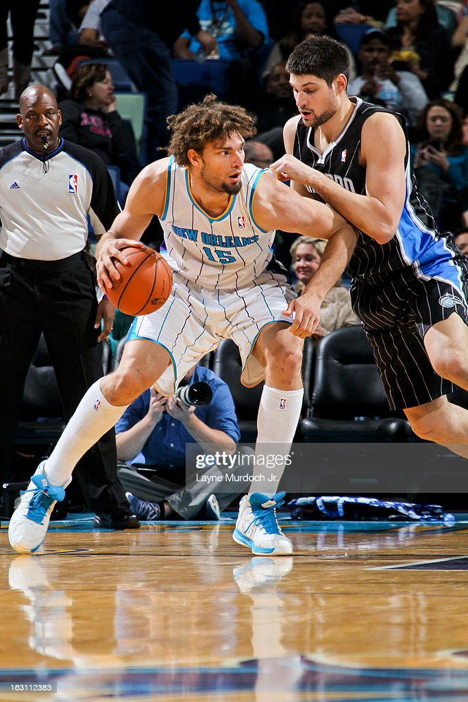 Robin Lopez #15 of the New Orleans Hornets posts-up against Nikola Vucevic #9 of the Orlando Magic on March 4, 2013 at the New Orleans Arena in New Orleans, Louisiana.