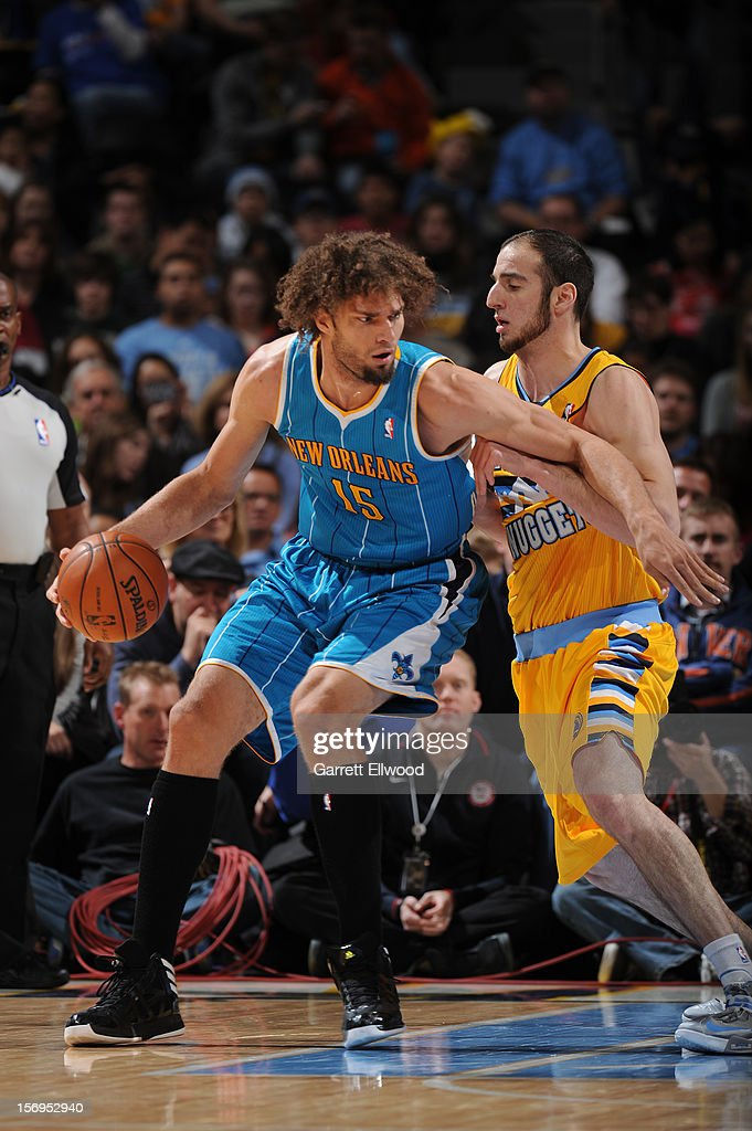 Robin Lopez #15 of the New Orleans Hornets protects the ball from Kosta Koufos #41 of the Denver Nuggets during the game between the New Orleans Hornets and the Denver Nuggets on November 25, 2012 at the Pepsi Center in Denver, Colorado.