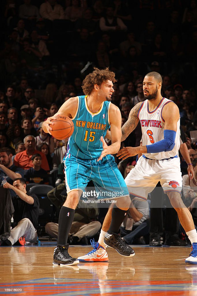 Robin Lopez #15 of the New Orleans Hornets protects the ball from Tyson Chandler #6 of the New York Knicks during the game between the New Orleans Hornets and the New York Knicks on January 13, 2013 at Madison Square Garden in New York City.