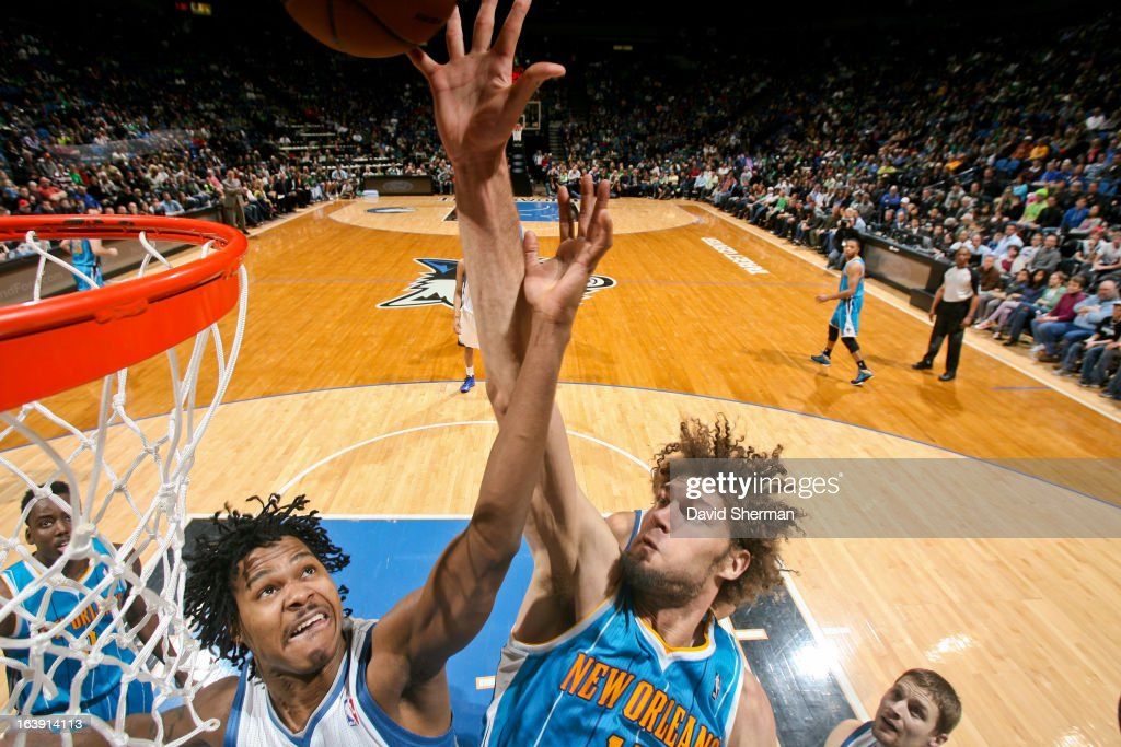 <a gi-track='captionPersonalityLinkClicked' href=/galleries/search?phrase=Robin+Lopez&family=editorial&specificpeople=2351509 ng-click='$event.stopPropagation()'>Robin Lopez</a> #15 of the New Orleans Hornets reaches for a rebound against <a gi-track='captionPersonalityLinkClicked' href=/galleries/search?phrase=Mickael+Gelabale&family=editorial&specificpeople=700549 ng-click='$event.stopPropagation()'>Mickael Gelabale</a> #15 of the Minnesota Timberwolves on March 17, 2013 at Target Center in Minneapolis, Minnesota.