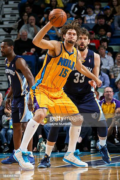 Robin Lopez of the New Orleans Hornets receives a pass against Marc Gasol of the Memphis Grizzlies on March 22 2013 at the New Orleans Arena in New...