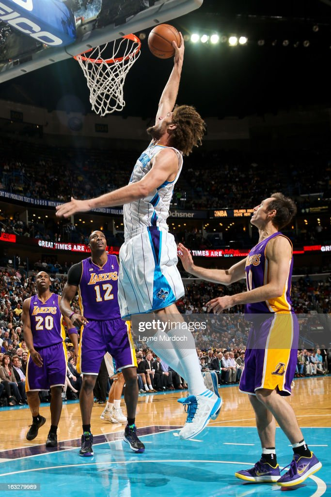 <a gi-track='captionPersonalityLinkClicked' href=/galleries/search?phrase=Robin+Lopez&family=editorial&specificpeople=2351509 ng-click='$event.stopPropagation()'>Robin Lopez</a> #15 of the New Orleans Hornets rises for a dunk against the Los Angeles Lakers on March 6, 2013 at the New Orleans Arena in New Orleans, Louisiana.