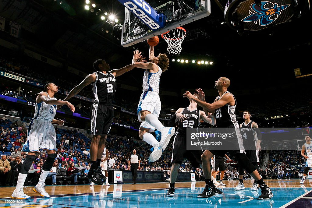 Robin Lopez #15 of the New Orleans Hornets shoots a layup against Kawhi Leonard #2 of the San Antonio Spurs on January 7, 2013 at the New Orleans Arena in New Orleans, Louisiana.