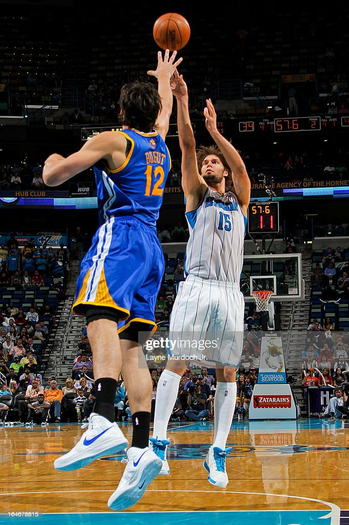 <a gi-track='captionPersonalityLinkClicked' href=/galleries/search?phrase=Robin+Lopez&family=editorial&specificpeople=2351509 ng-click='$event.stopPropagation()'>Robin Lopez</a> #15 of the New Orleans Hornets shoots against <a gi-track='captionPersonalityLinkClicked' href=/galleries/search?phrase=Andrew+Bogut&family=editorial&specificpeople=207105 ng-click='$event.stopPropagation()'>Andrew Bogut</a> #12 of the Golden State Warriors on March 18, 2013 at the New Orleans Arena in New Orleans, Louisiana.