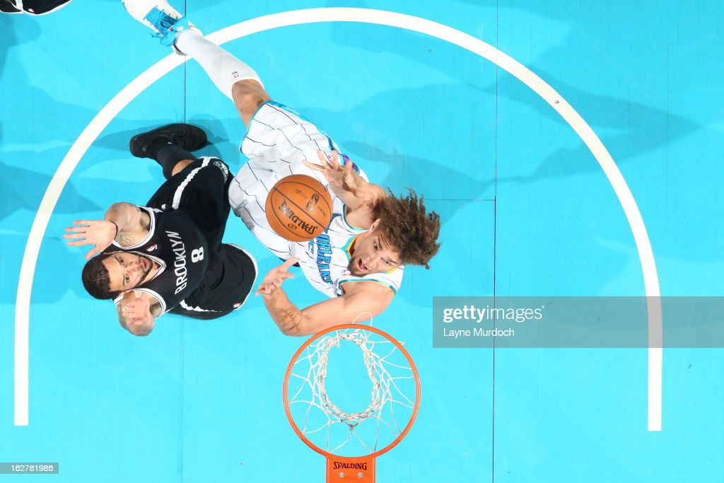 <a gi-track='captionPersonalityLinkClicked' href=/galleries/search?phrase=Robin+Lopez&family=editorial&specificpeople=2351509 ng-click='$event.stopPropagation()'>Robin Lopez</a> #15 of the New Orleans Hornets shoots against <a gi-track='captionPersonalityLinkClicked' href=/galleries/search?phrase=Deron+Williams&family=editorial&specificpeople=203215 ng-click='$event.stopPropagation()'>Deron Williams</a> #8 of the Brooklyn Nets on February 26, 2013 at the New Orleans Arena in New Orleans, Louisiana.