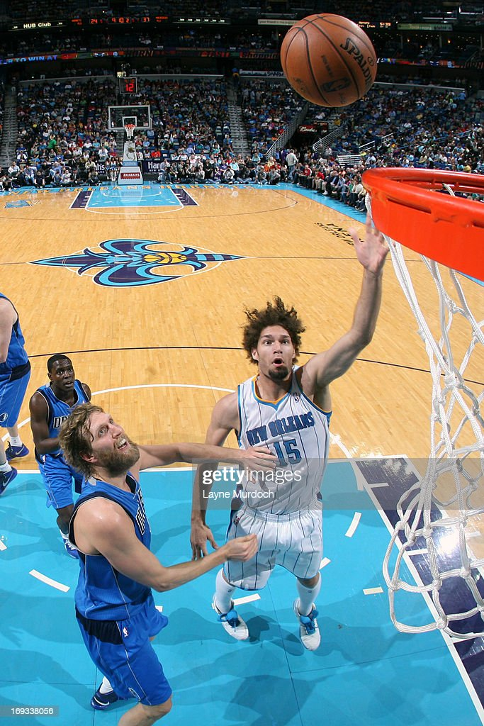 <a gi-track='captionPersonalityLinkClicked' href=/galleries/search?phrase=Robin+Lopez&family=editorial&specificpeople=2351509 ng-click='$event.stopPropagation()'>Robin Lopez</a> #15 of the New Orleans Hornets shoots against <a gi-track='captionPersonalityLinkClicked' href=/galleries/search?phrase=Dirk+Nowitzki&family=editorial&specificpeople=201490 ng-click='$event.stopPropagation()'>Dirk Nowitzki</a> #41 of the Dallas Mavericks on April 14, 2013 at the New Orleans Arena in New Orleans, Louisiana.