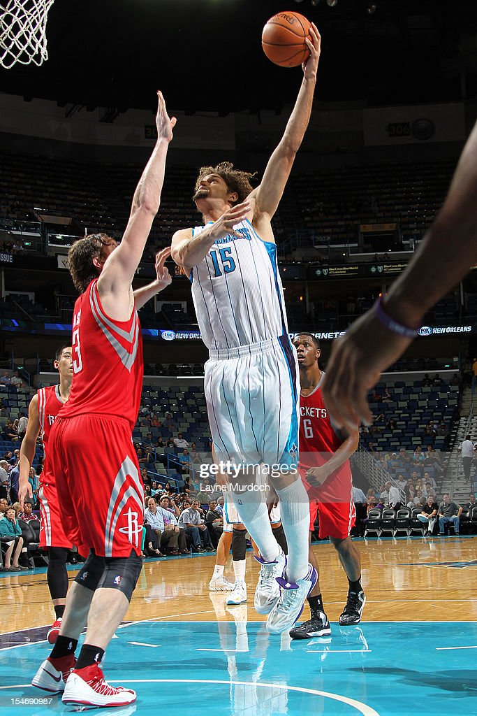 <a gi-track='captionPersonalityLinkClicked' href=/galleries/search?phrase=Robin+Lopez&family=editorial&specificpeople=2351509 ng-click='$event.stopPropagation()'>Robin Lopez</a> #15 of the New Orleans Hornets shoots against the Houston Rockets on October 24, 2012 at the New Orleans Arena in New Orleans, Louisiana.
