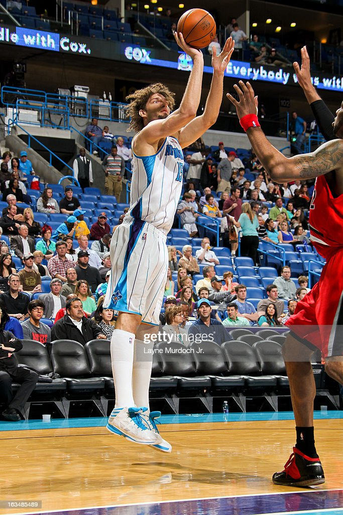 <a gi-track='captionPersonalityLinkClicked' href=/galleries/search?phrase=Robin+Lopez&family=editorial&specificpeople=2351509 ng-click='$event.stopPropagation()'>Robin Lopez</a> #15 of the New Orleans Hornets shoots against the Portland Trail Blazers on March 10, 2013 at the New Orleans Arena in New Orleans, Louisiana.