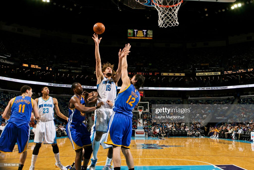 <a gi-track='captionPersonalityLinkClicked' href=/galleries/search?phrase=Robin+Lopez&family=editorial&specificpeople=2351509 ng-click='$event.stopPropagation()'>Robin Lopez</a> #15 of the New Orleans Hornets shoots in the lane against <a gi-track='captionPersonalityLinkClicked' href=/galleries/search?phrase=Andrew+Bogut&family=editorial&specificpeople=207105 ng-click='$event.stopPropagation()'>Andrew Bogut</a> #12 of the Golden State Warriors on March 18, 2013 at the New Orleans Arena in New Orleans, Louisiana.