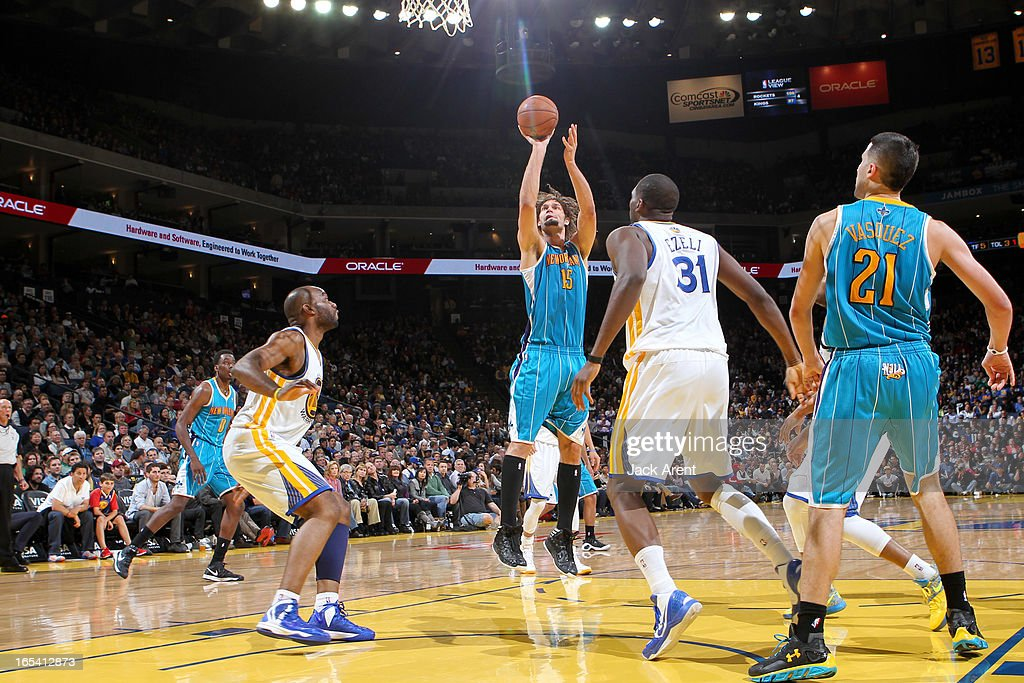 <a gi-track='captionPersonalityLinkClicked' href=/galleries/search?phrase=Robin+Lopez&family=editorial&specificpeople=2351509 ng-click='$event.stopPropagation()'>Robin Lopez</a> #15 of the New Orleans Hornets shoots in the lane against <a gi-track='captionPersonalityLinkClicked' href=/galleries/search?phrase=Carl+Landry&family=editorial&specificpeople=4111952 ng-click='$event.stopPropagation()'>Carl Landry</a> #7 and <a gi-track='captionPersonalityLinkClicked' href=/galleries/search?phrase=Festus+Ezeli&family=editorial&specificpeople=5725219 ng-click='$event.stopPropagation()'>Festus Ezeli</a> #31 of the Golden State Warriors on April 3, 2013 at Oracle Arena in Oakland, California.