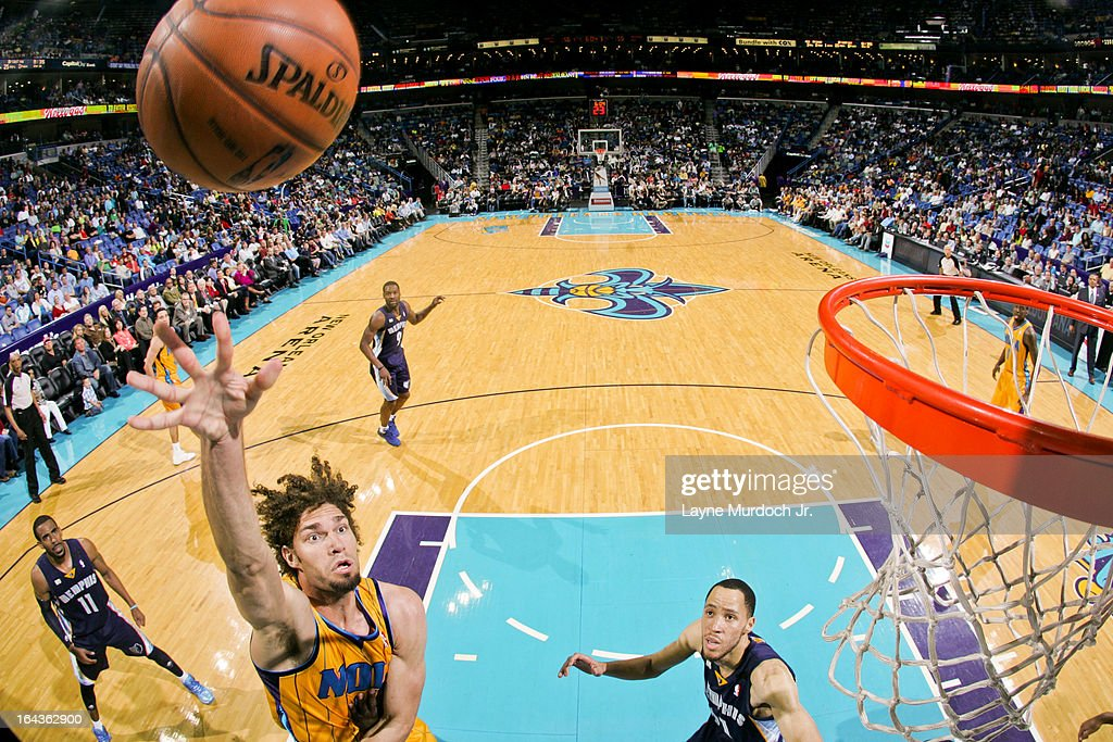 <a gi-track='captionPersonalityLinkClicked' href=/galleries/search?phrase=Robin+Lopez&family=editorial&specificpeople=2351509 ng-click='$event.stopPropagation()'>Robin Lopez</a> #15 of the New Orleans Hornets shoots in the lane against the Memphis Grizzlies on March 22, 2013 at the New Orleans Arena in New Orleans, Louisiana.