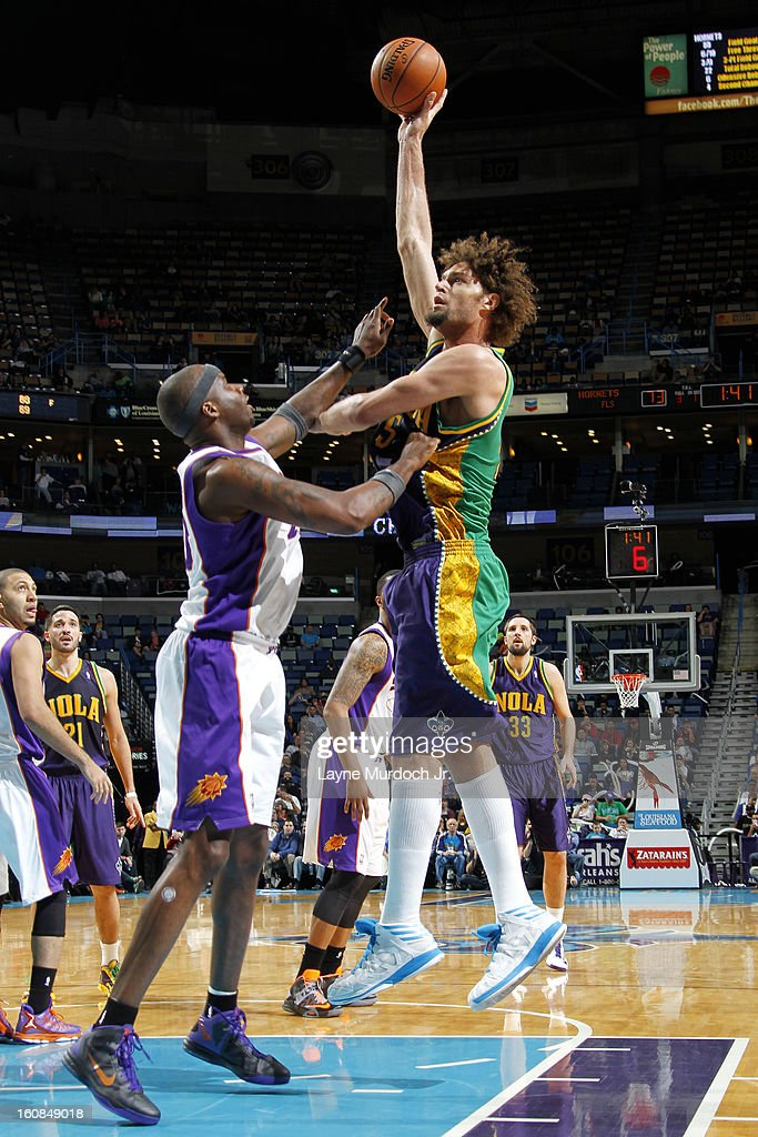 Robin Lopez #15 of the New Orleans Hornets shoots over Jermaine O'Neal #20 of the Phoenix Suns on February 06, 2013 at the New Orleans Arena in New Orleans, Louisiana.