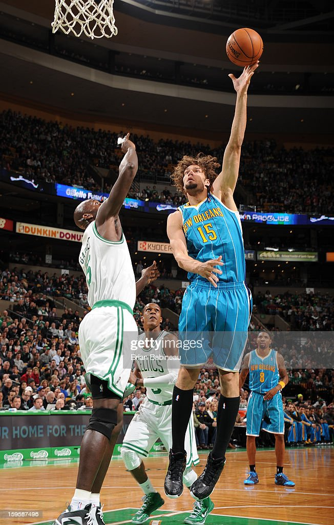 Robin Lopez #15 of the New Orleans Hornets shoots the ball against Kevin Garnett #5 of the Boston Celtics on January 16, 2013 at the TD Garden in Boston, Massachusetts.