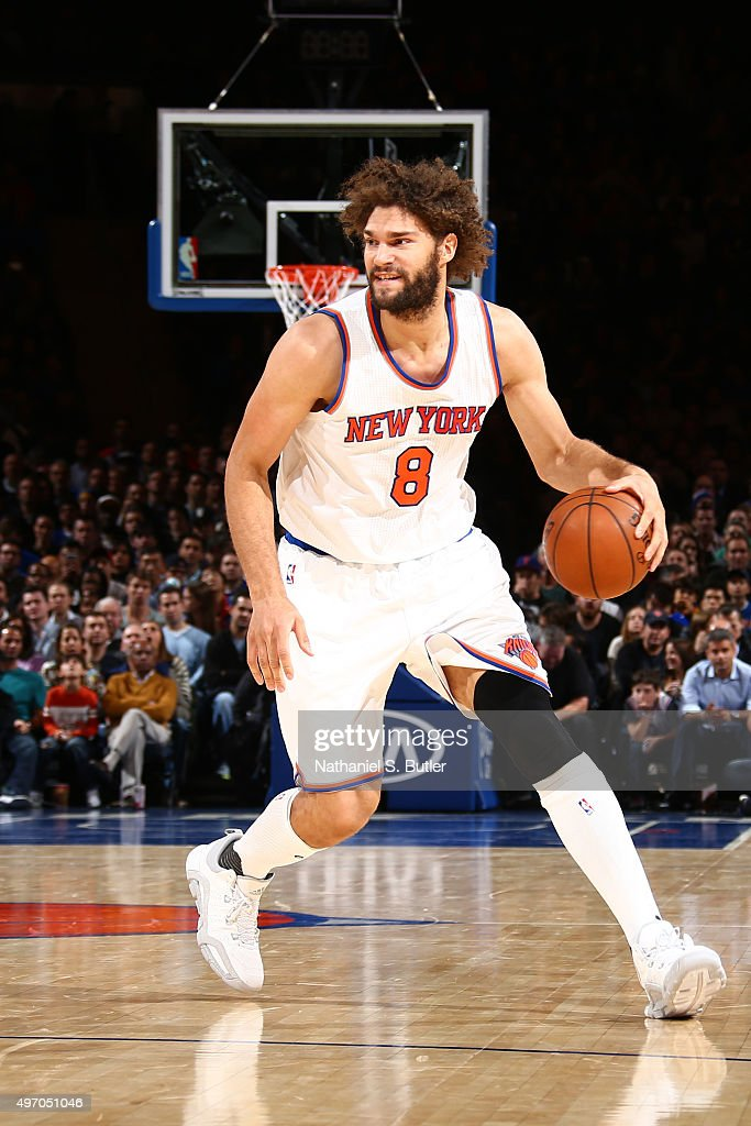 Robin Lopez of the New York Knicks brings the ball up court against the Cleveland Cavaliers on November 13 2015 at Madison Square Garden in New York...