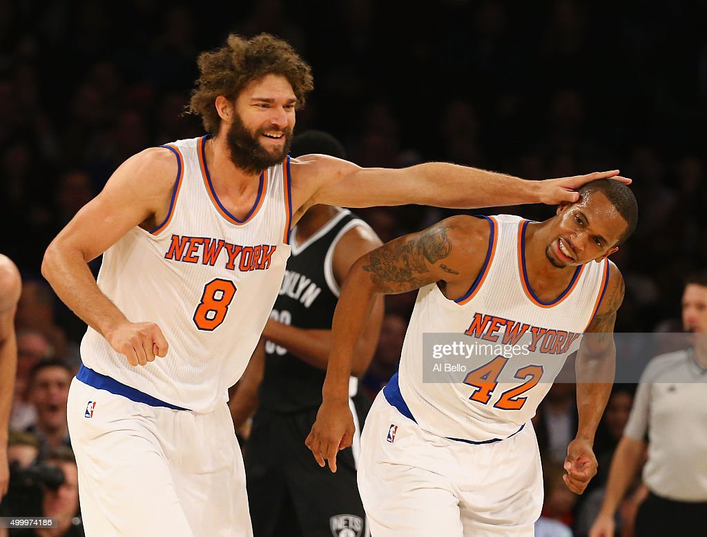 Robin Lopez of the New York Knicks celebrates a basket by Lance Thomas during their game against the Brooklyn Nets at Madison Square Garden on...