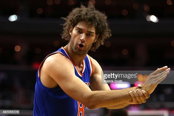 Robin Lopez of the New York Knicks gestures to the referee against the Washington Wizards during the first half at Verizon Center on October 9 2015...