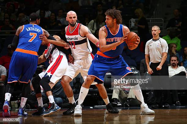 Robin Lopez of the New York Knicks handles the ball against the Washington Wizards during a preseason game on October 9 2015 at Verizon Center in...