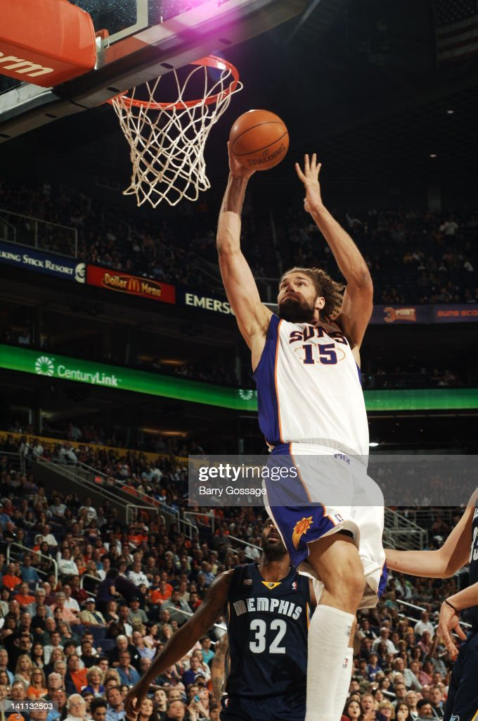 <a gi-track='captionPersonalityLinkClicked' href=/galleries/search?phrase=Robin+Lopez&family=editorial&specificpeople=2351509 ng-click='$event.stopPropagation()'>Robin Lopez</a> #15 of the Phoenix Suns drives for a shot against the Memphis Grizzlies in an NBA game played on March 10, 2012 at U.S. Airways Center in Phoenix, Arizona.
