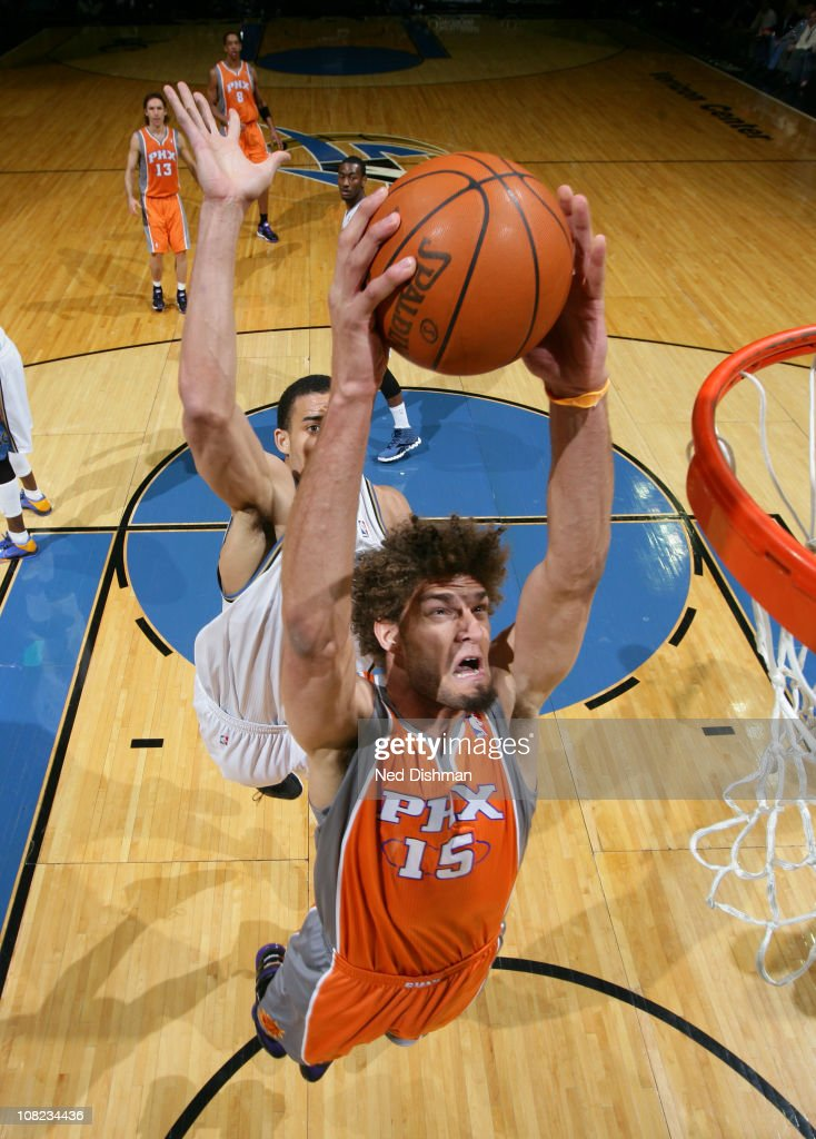 Robin Lopez of the Phoenix Suns dunks against JaVale McGee of the Washington Wizards at the Verizon Center on January 21 2011 in Washington DC NOTE...